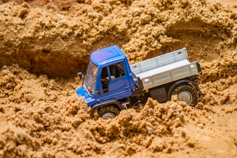 Close-up of toy truck in sand outdoors