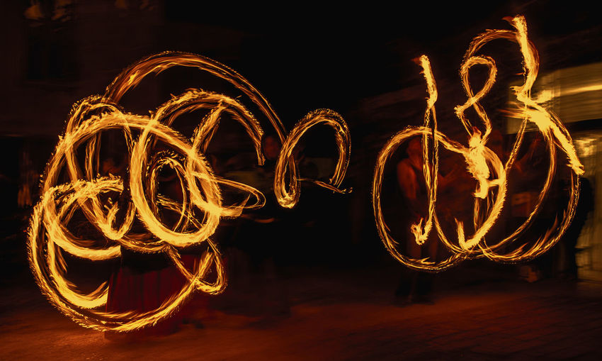 Abstract Arts Culture And Entertainment Dark Fire Fireboys Glowing Illuminated Light Light Painting Light Trail Motion Multi Colored Night No People Outdoors Fine Art Photography