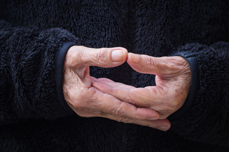 Close-up of wrinkled hands elderly woman