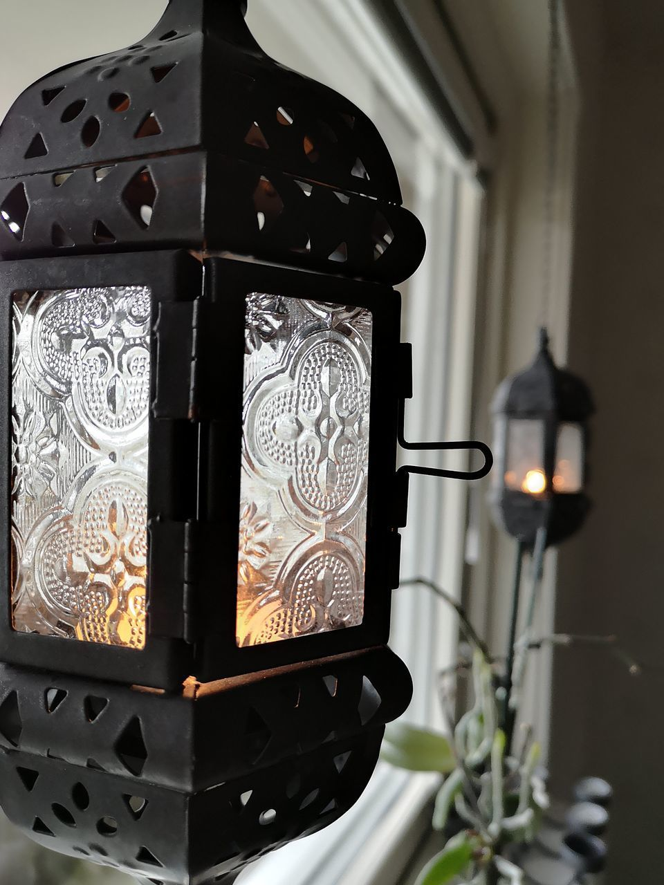 lighting equipment, indoors, no people, close-up, illuminated, pattern, electric lamp, home interior, design, focus on foreground, black color, metal, heat - temperature, technology, burning, glowing, art and craft, floral pattern, candle, ornate