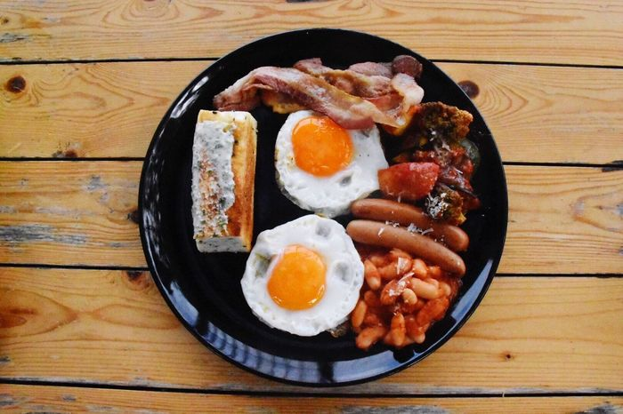 Fried Egg Egg Food Food And Drink Breakfast Table Fried Bacon No People English Breakfast High Angle View Egg Yolk Sausage Indoors  Directly Above Meat Skillet- Cooking Pan Sunny Side Up Healthy Eating Close-up