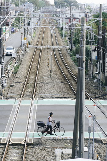 Cyclists crossing the railroad Transportation Mode Of Transportation Bicycle Railroad Track Rail Transportation Track Land Vehicle Real People Architecture High Angle View Lifestyles Men Riding Full Length Travel People Ride Built Structure Day Outdoors Diminishing Perspective