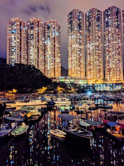 Panoramic view of harbor and buildings at night