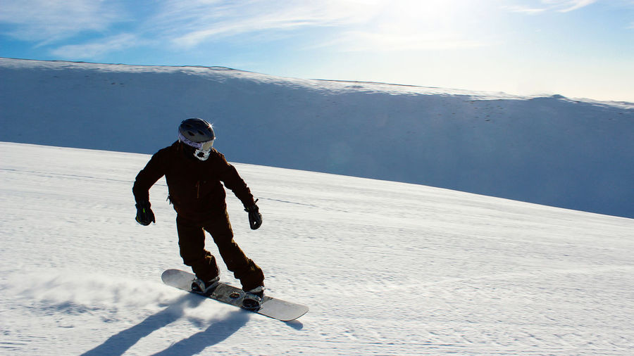 snowboarding on the ski slope. healthy lifestyle, outdoor recreation on a winter day