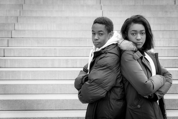 Black Black & White Couple - Relationship Day Friendship Front View Jacket Lifestyles Looking At Camera Men Outdoors Portrait Real People Standing The Portraitist - 2017 EyeEm Awards Three Quarter Length Togetherness Two People University Student Warm Clothing Well-dressed Winter Young Adult Young Men Young Women
