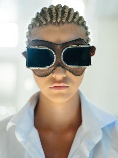 Close-up portrait of a man wearing sunglasses