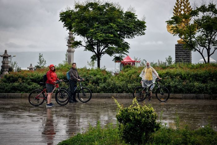 Rain Rainfall Adult Bicycle Cloud - Sky Cycling Helmet Day Headwear Helmet Leisure Activity Lifestyles Men Nature Outdoors Rain Gear Real People Sky Togetherness Tourism Transportation Water Young Adult Summer Exploratorium The Traveler - 2018 EyeEm Awards Summer Road Tripping