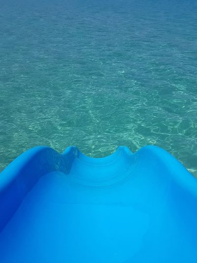 Blue Slide Slide Into Water Turquoise Sea The Way Down No Filter, No Edit, Just Photography High Angle View Close-up Of Slide Transparent Sea Water No People Outdoors