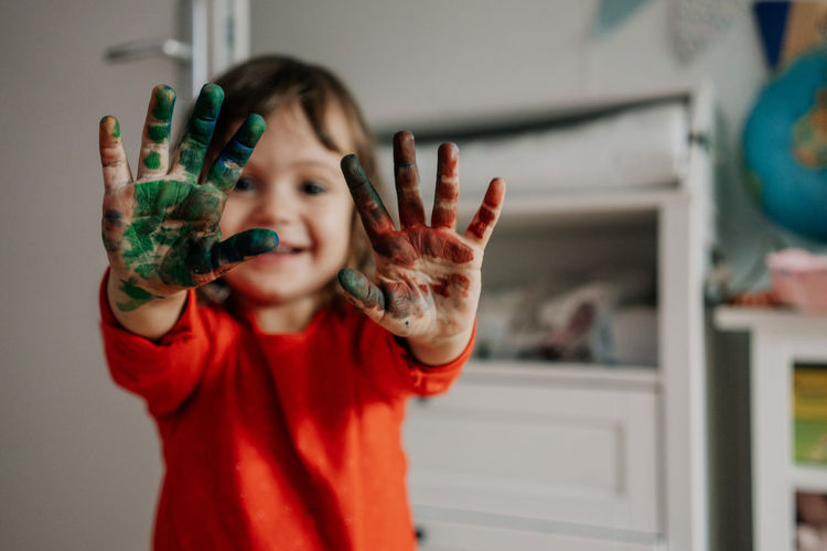 Hand Paint Hand Painting, Headshot Children Children Only Childhood Paint Painting Kids Kids Being Kids Fun Parenting Dirty Hands Child Human Body Part One Person Portrait Focus On Foreground Casual Clothing Innocence Hand Raised Arms Raised Indoors