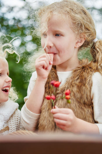 Rose Hip Haw Blond Hair Celebration Cheerful Child Childhood Christmas Close-up Cute Day Elementary Age Food And Drink Front View Girls Happiness Headshot Holding Indoors  Leisure Activity Lifestyles Real People Smiling Togetherness Tree Two People