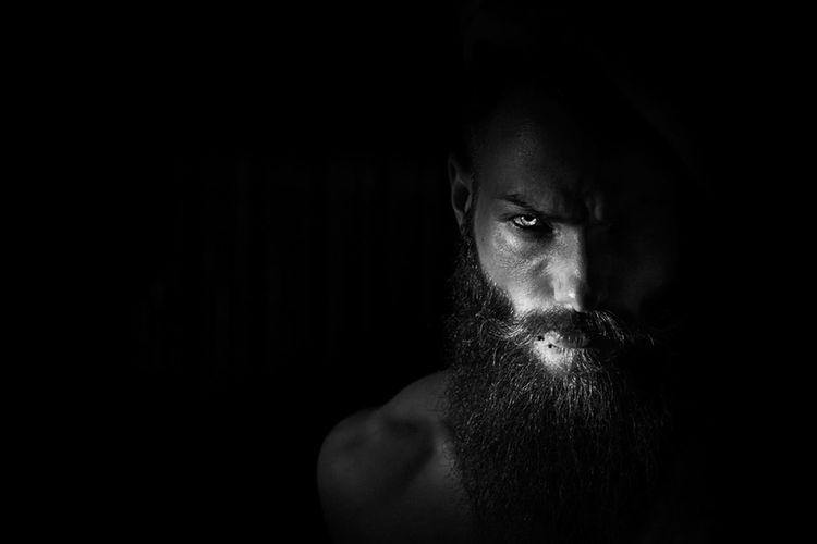 The angels' fall EyeEm Selects Eyeemphotography EyeEm Masterclass Beard EyeEm Photo Black And White Mood Contrast Eyes Model Man Beard Looking At Camera Vogue Close-up Black Background The Portraitist - 2018 EyeEm Awards