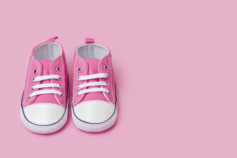 Cute pink baby girl sneakers close up on pink background Foot Jeans Shoe Calendar Footwear Two Sentimental Pink Feminine  Kid Wear Childhood Born Family Sport First Fashion Booties Baby Newborn Clothes Pair Blue Denim Birthday Pregnant Parenting Shopping Sneaker Soft Casual Trendy Symbol Infant Motherhood Toddler  New Pregnancy Clothing Style Card Child Space For Text Tiny Birth Girl Month Background Small Pink Color Studio Shot Still Life Copy Space Indoors  No People Two Objects Colored Background Canvas Shoe Shoelace Compatibility Close-up Cut Out High Angle View Pink Background Red Personal Accessory Dress Shoe Womenswear