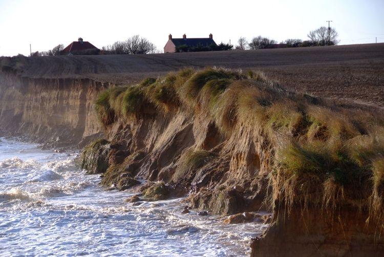 Coastal erosion. Storm surge southwold Southwold Storm Surge Cliffs Coastal Erosion Built Structure Water Architecture Nature Building Exterior Sky Plant