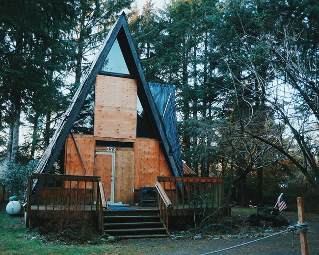 Triangle Boarded Up A Frame Aframe Pacific Northwest  Architecture Abandoned Abandoned House Tree Built Structure Day No People Architecture Outdoors Nature