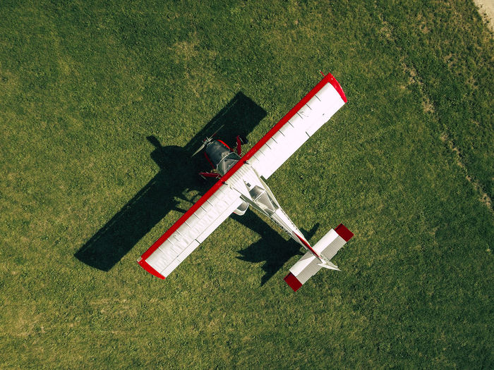 High angle view of biplane on grassy field