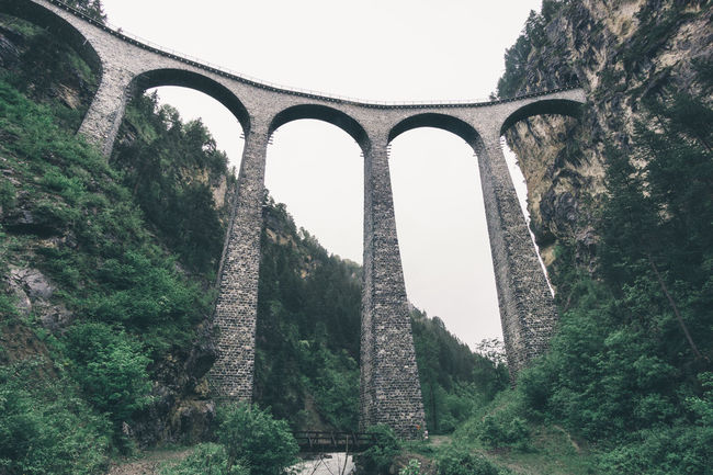Landwasser viaduct, a single track railway bridge in Graubünden, Switzerland Antique Architecture Bridge Cloudy Cloudy Weather Graubünden Green Forest History Landscape Landwasser Landwasser Viadukt  Mysterious Old Architecture Old Buildings Perspective Rhätische Bahn S Schweiz Single Track Train Bridge Switzerland Symmetry Tall Construction Train Bridge Travel Viaduct