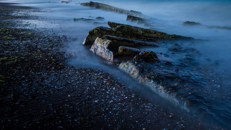 Rocks at shore of beach
