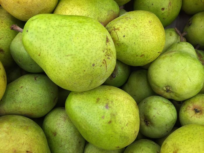 Fruit Freshness Food Healthy Eating Food And Drink Green Color Full Frame Large Group Of Objects No People Market Pear Backgrounds Market Stall For Sale Close-up Outdoors Day