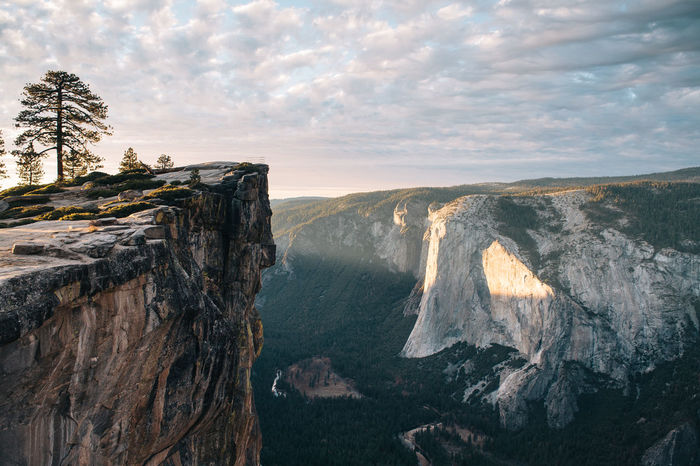 Yosemite cliff. Awe Beauty In Nature Cliff Cliffside Cloud - Sky Day Dramatic Sky Landscape Landscape Photography Nature No People Outdoors Scenics Sea Sky Sunset Travel Destinations Vacations Water Waterfall Wilderness Yosemite Yosemite National Park Fresh On Market 2016