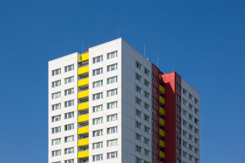 Berlin's Plattebau. FILIPPI GIULIA PHOTOGRAPHY. Apartment Architecture Berlin Blue Building Building Exterior Built Structure Canon City Clear Sky Colorful Colors Germany House Outdoors Pattern Photographer Photography Photooftheday Picoftheday Plattenbau Repetition Sky Skyscraper Window