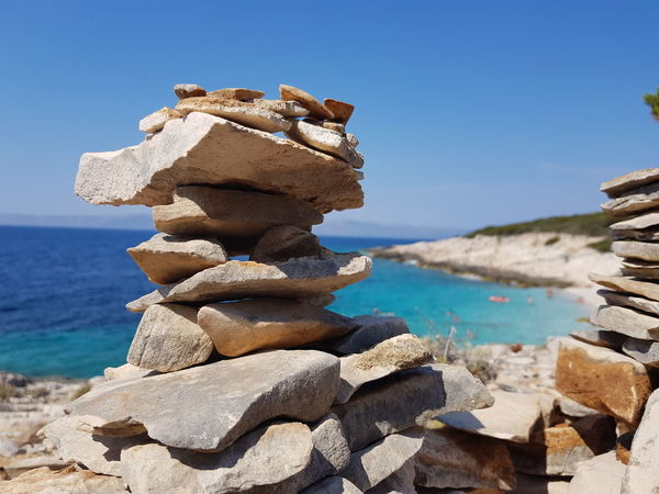 Stack Sea Beach Rock - Object Water Balance Nature No People Tranquil Scene Tranquility Beauty In Nature Day Outdoors Travel Destinations Summer Large Group Of Objects Landscape Scenics Vacations Sky stones Hot Stones Kroatia Health Spa Happyness