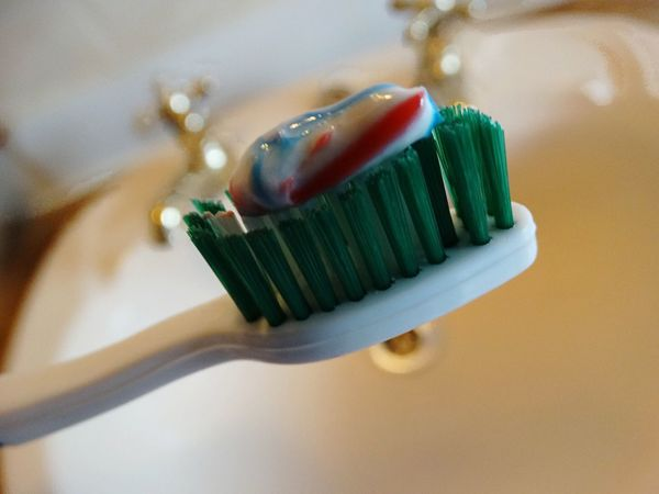 Toothbrush and toothpaste over sink. Bathroom Toothpaste Toothbrush Sink Paste Dentistry Brush Hygiene Cleaning Cleaning Teeth Brushing Teeth  Clean Brushing Teeth Bristles Dental Care Health Healthy Lifestyle Lifestyles Life Healthy