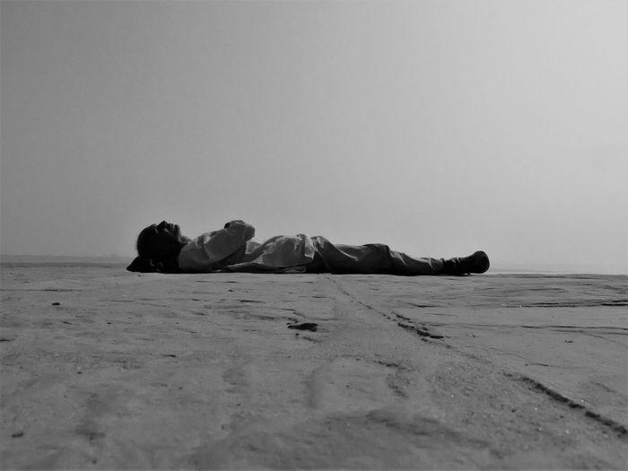 Man lying in sea