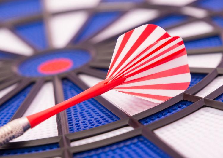 Close-up of dart on dartboard