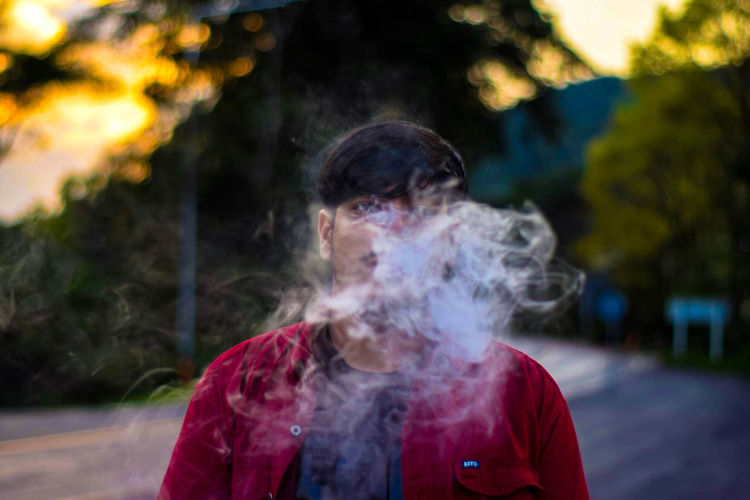 Smoke - Physical Structure Focus On Foreground Smoking Issues Bad Habit One Person Smoking - Activity Day Outdoors RISK Warning Sign Communication