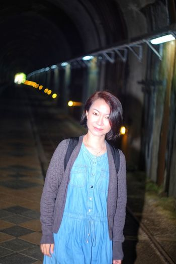 Portrait of woman standing in tunnel