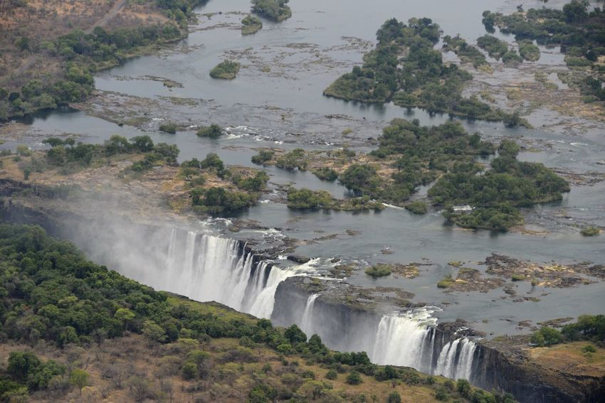 Arial Shot National Park Victoria Falls Africa Zimbabwe Zambesi River Zambia Zimbabwe Arial Arial Photography Arial View Arialview Beauty In Nature Border Flowing Water High Angle View Nature Power In Nature River Scenics Travel Destinations Victoria Falls Victoria Falls In Zambia, Africa View From Helicopter Water Waterfall Zambesi