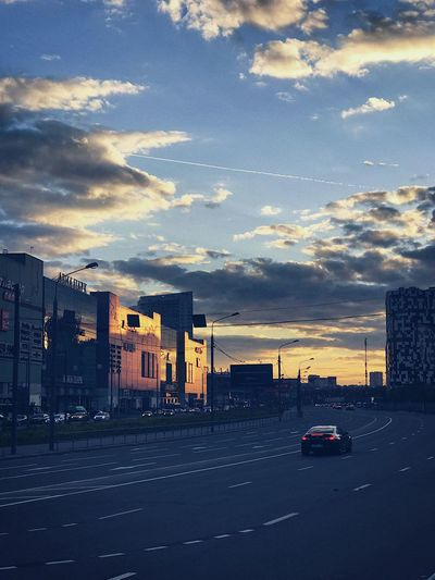 Aviapark in Moscow. Fresh evening Architecture Building Exterior Built Structure Sunset City Sky Cloud - Sky Road Car Transportation Outdoors Street City Life No People Skyscraper Travel Destinations Land Vehicle Day Cityscape The Street Photographer - 2017 EyeEm Awards