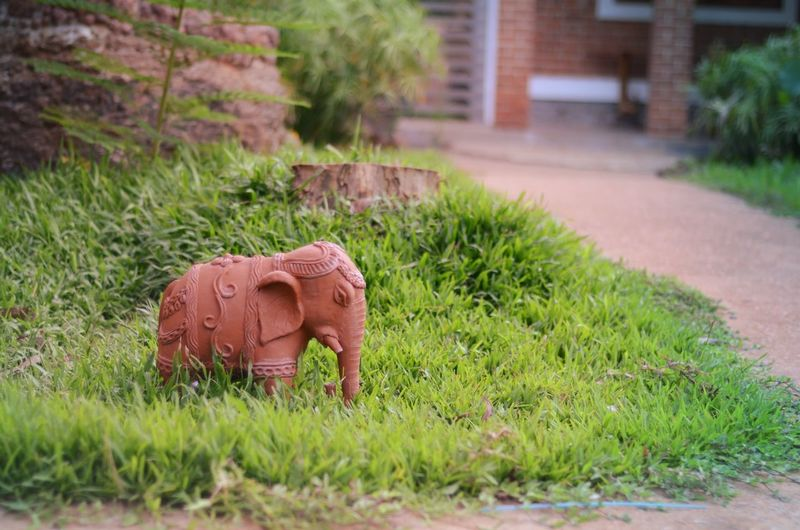 Close-Up View Of Elephant Sculpture On Grass