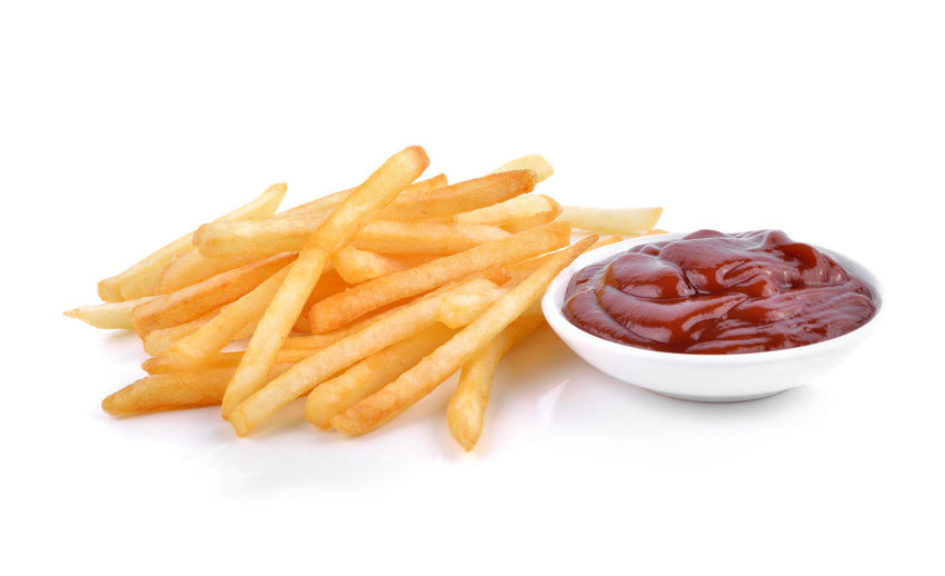 High angle view of bread and fries on white background