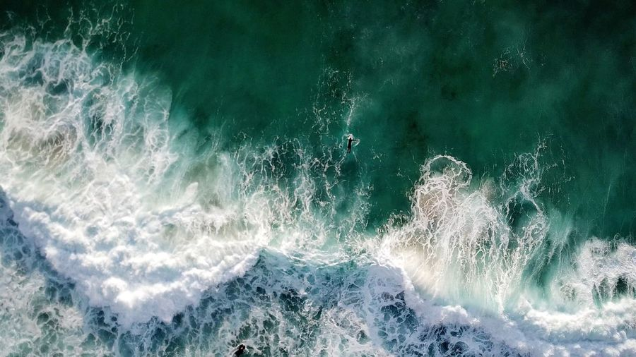 High angle view of water splashing in sea