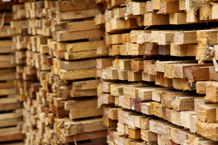stack of timber wood Wood Abundance Arrangement Backgrounds Close-up Day Forestry Industry Freight Transportation Full Frame Heap Industry Large Group Of Objects Lumber Industry Material Merchandise Shelf Shipping  Stack Storage Compartment Textured  Timber Timber Wood Warehouse Wood - Material Woodpile