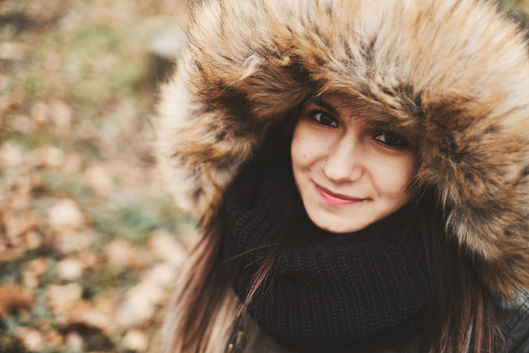 Beautiful Woman Clothing Coat Cold Temperature Front View Fur Fur Coat Hair Hairstyle Happiness Headshot Hood - Clothing Leisure Activity Lifestyles Looking At Camera One Person Outdoors Portrait Scarf Smiling Warm Clothing Winter Women Young Adult Young Women