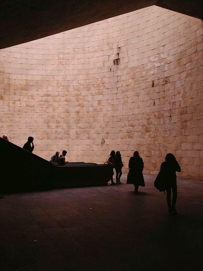Silhouette people walking at underground walkway
