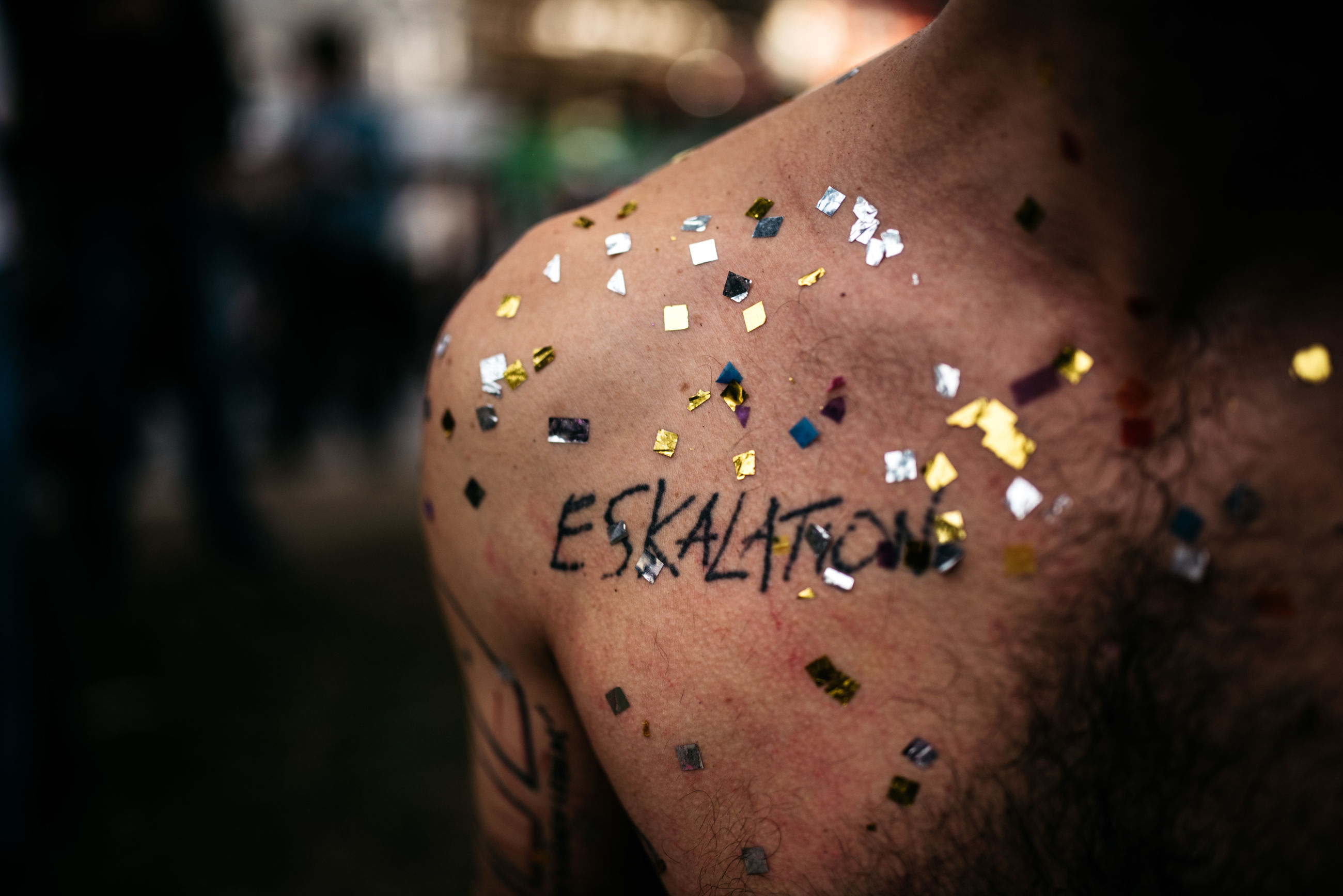 close-up, human body part, focus on foreground, body part, skin, one person, real people, human skin, tattoo, creativity, indoors, selective focus, text, food and drink, food, limb, day, human limb, brown, temptation