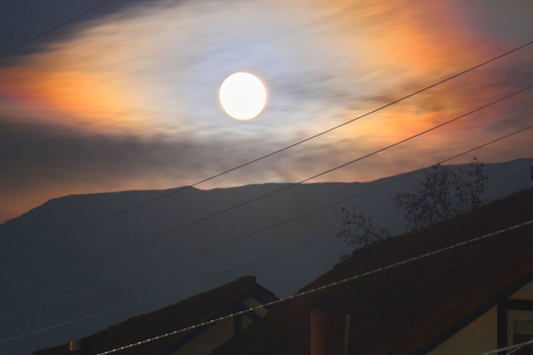 Low angle view of moon against sky during sunset