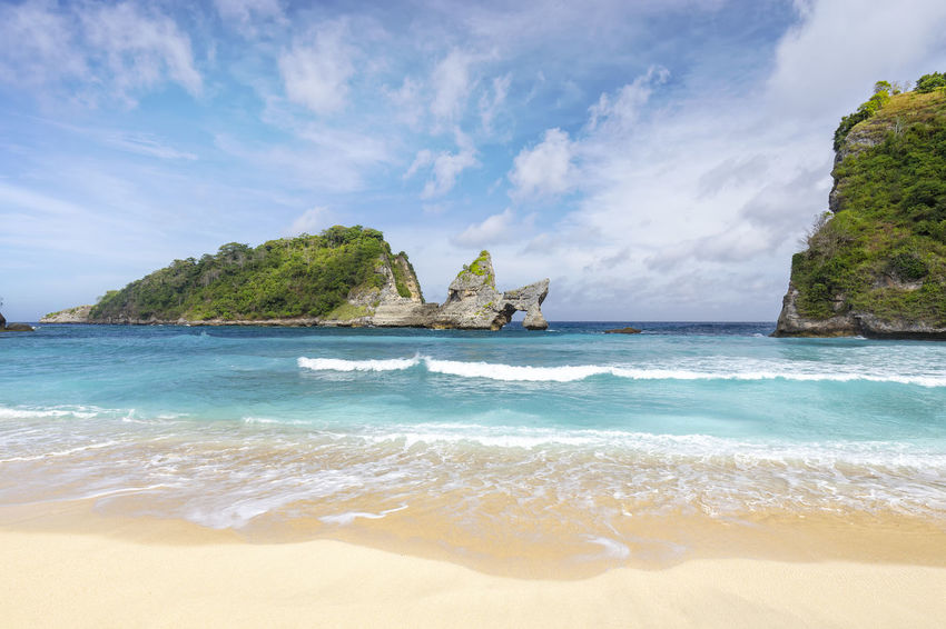 A beautiful view of Atuh Beach in Nusa Penida, a small island off of Bali. ASIA Atuh Beach Bali Diving INDONESIA Snorkeling Sunny Travel Aquamarine Atuh Balinese Beach Blue Destination Diamond Klungkung Nusa Penida Paradise Pejukutan Relax Summer Swim Tourism Tropical White Sand