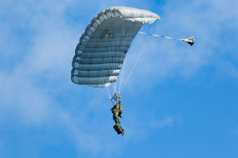 Swedish Armed forces demonstration day Parachute Jump Swedish Airforce Adventure Air Force Airshow Army Soldier Day Flying Full Length Low Angle View Mid-air Military One Person Parachute Paratrooper Real People Sky Skydiving Stunt
