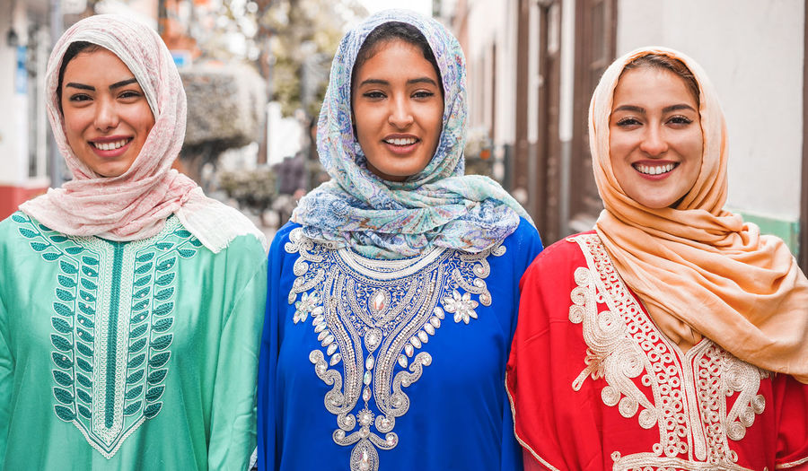 Portrait of three arabian young women friends Smiling Happiness Women Portrait Emotion Young Women Young Adult Friendship Togetherness Group Of People Arabic Arabian Muslim Hijab Millenials