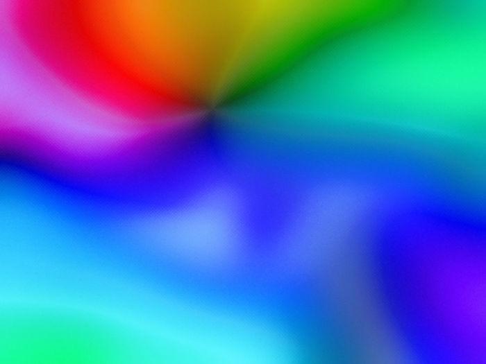 Full frame shot of rainbow over blue background