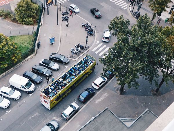 A Bird's Eye View Paris Transportation Land Vehicle Car High Angle View Mode Of Transport Street Tree On The Move City Motion City Street Day Vehicle City Life Embrace Urban Life מייסטריט מייפריס Adapted To The City The Street Photographer - 2017 EyeEm Awards Your Ticket To Europe
