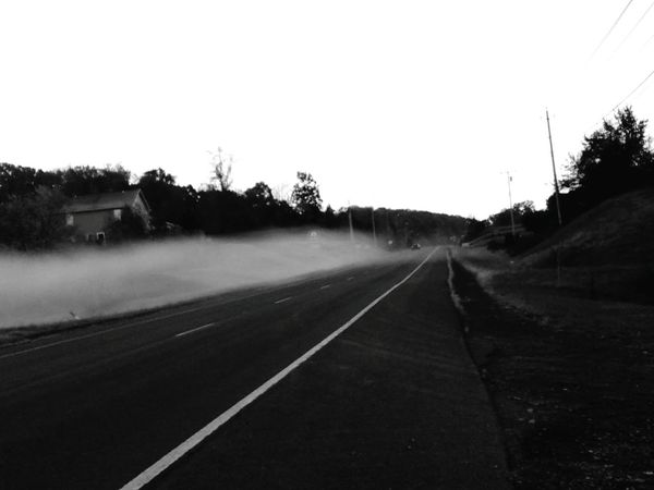 Tree Road The Way Forward Sky Sunset Outdoors No People Nature Beauty In Nature Day Motorsport Silhouette Landscape Foggy Landscape Fog Blanket In The Mountains Black And White Photography Beauty In Nature Tranquility Rural Scene