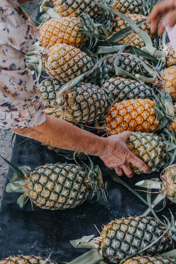 Food And Drink Food Hand Healthy Eating Freshness Human Hand Wellbeing Basket People Human Body Part Real People Market Retail  Fruit Day Pineapple Holding Men Large Group Of Objects Outdoors Sweetcorn Finger Pineapple Pineapple Fruit
