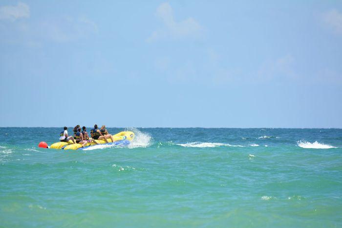 Banana boat rides Hollywood Beach FL Heat - Temperature Travel Destinations Outdoors Vacations Fun In The Sun Fun Joy Ride Banana Boat Recreational Pursuit Recreational Vehicle Recreational Activities  Beach Seashore Real People