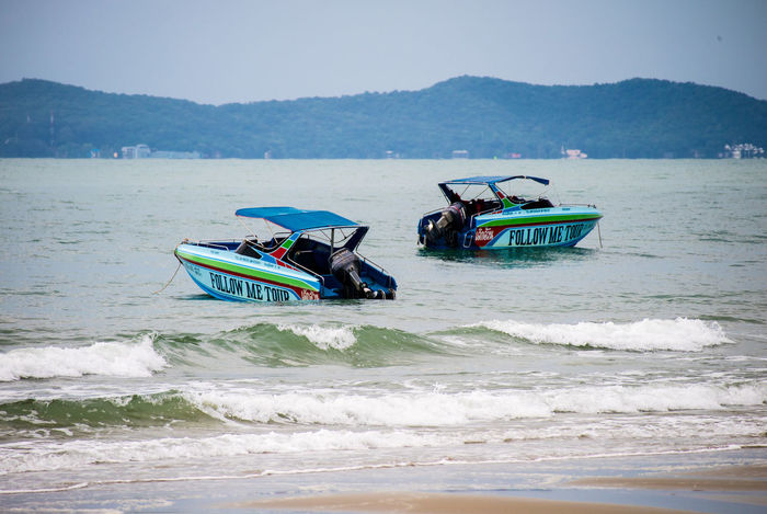 Adventure Aquatic Sport Beach Beauty In Nature Day Leisure Activity Mode Of Transportation Motion Mountain Nature Nautical Vessel Outdoors People Real People Sea Sky Sport Transportation Water Wave