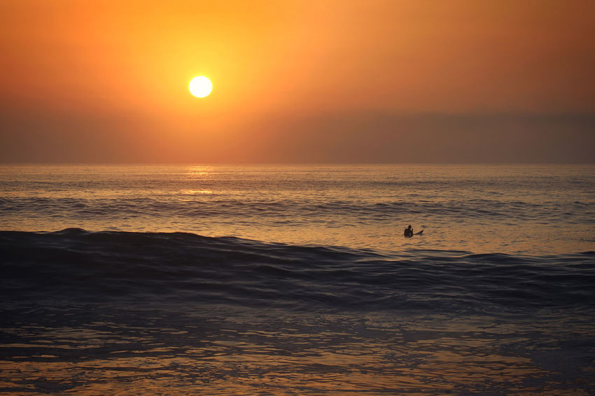 Idyllic Lineup Majestic Non-urban Scene Ocean Orange Color Outdoors Scenics Seascape Sunset Surf Surfer Tranquil Scene Tranquility Wave